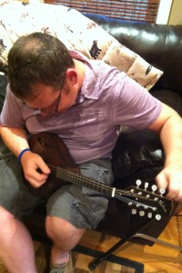 jim vancleve tuning a mandolin